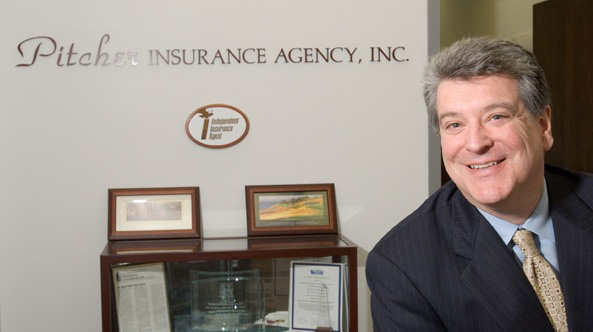 About Our Agency - Portrait of Ron Pitcher in His Office Next to Pitcher Insurance Awards